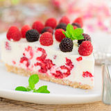 A Piece of No-bake Raspberry Cheesecake. A Piece of No-bake Fresh Raspberry Cheesecake with Red and Black Raspberries and Melissa, Summer Cake, square, close up Stock Photos