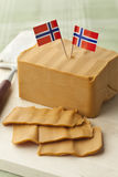 Piece of norwegian cheese Stock Images