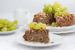 Piece of nut pie with grapes Stock Photo
