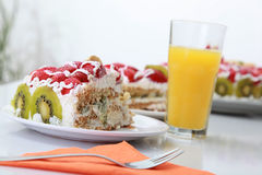 Free Piece Of Homemade Cake Is Served With Orange Juice Stock Photo - 32855440