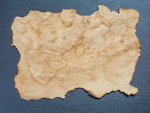 Piece of old paper and old paper roll. On background stock image