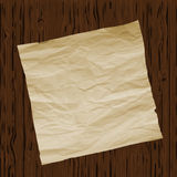 Piece of old paper on wooden texture background. Image trace. Vector illustration. Stock Image