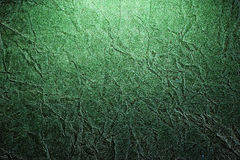 Piece of old rumpled green paper as background Royalty Free Stock Images