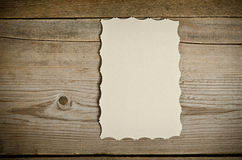 The piece of old white paper lying on a wooden background Stock Photography