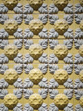 A piece of an old yellow floral ceramic tile in Portugal Stock Photo