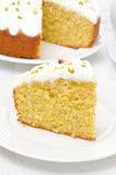 Piece of orange cake with Greek yogurt, honey and pistachios Royalty Free Stock Photography