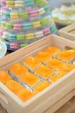 Piece of orange cake in wooden box Stock Photo