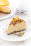 Piece of orange cheesecake with chocolate on a plate, vertical Royalty Free Stock Image