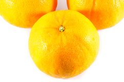Piece of orange fruit in white background Royalty Free Stock Images