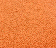 A piece of orange natural leather Stock Photos