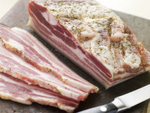 Piece of Pancetta and Slices stock photography