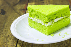 Piece of pandan cake. On  plastic plate Royalty Free Stock Photography