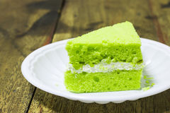 Piece of pandan cake. On  plastic plate Royalty Free Stock Images