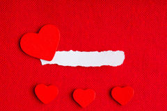 Piece paper blank copyspace hearts on red fabric textile material Royalty Free Stock Image