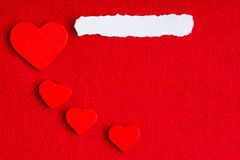 Piece paper blank copyspace hearts on red fabric textile material Stock Images