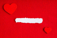 Piece paper blank copyspace hearts on red fabric textile material Royalty Free Stock Photography