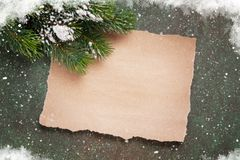 Piece of paper for christmas wishes. And snow xmas tree. Top view with space for your text royalty free stock photography