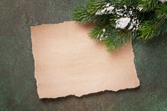 Piece of paper for christmas wishes. And snow xmas tree. Top view with space for your text stock photography