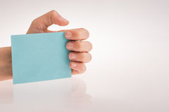 Piece of paper in hand Royalty Free Stock Images
