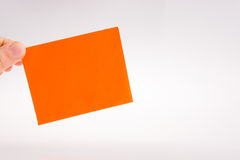 Piece of paper in hand Royalty Free Stock Photos