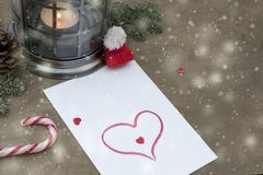 Piece of paper with heart, candy, candle royalty free stock photography