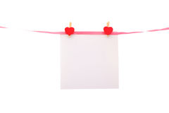 Piece of paper on line with hearth shaped pins Stock Photos