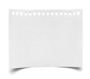 Piece of paper note notepad. Close up of a piece of note paper on white background royalty free stock photo