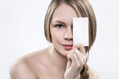 A piece of paper for notes in the hands of a blonde. Stock Photos