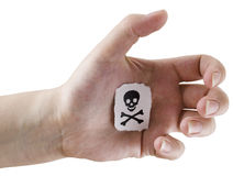 Piece of paper on a palm. Fragmentary piece of paper with drawn jolly Roger on a palm Stock Photo