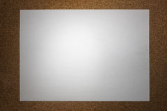 Piece of paper. On cork board texture Stock Image