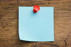 A piece of paper pinned the button Stock Image