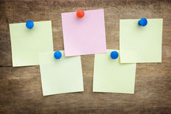 A piece of paper pinned the button Royalty Free Stock Images