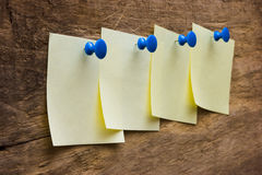 A piece of paper pinned the button Royalty Free Stock Photography