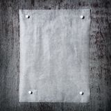 a piece of paper pinned to a gray wooden background. Frame from Stock Photography