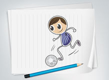 A piece of paper with a soccer player Royalty Free Stock Images