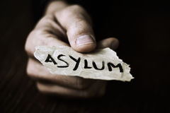 Piece of paper with the word asylum Stock Images