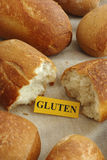 Piece of paper with the word gluten in a bun Royalty Free Stock Images