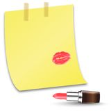 A piece of paper with the word love and lip prints. Open lipstick and place for text. Stock Photography
