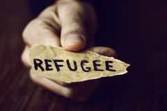 Piece of paper with the word refugee Stock Photos