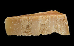 A piece of Parmesan cheese isolated all focused Stock Photo