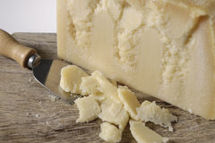 Piece of parmesan cheese seasoned with cutting board Royalty Free Stock Photos