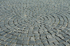 A piece of a  paved road. In a city Stock Image