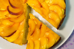 Piece of peach cake. Flat lay top view close-up Royalty Free Stock Photo