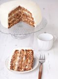 A piece of pecan cake with buttercream icing Stock Image