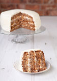 A piece of pecan cake with buttercream icing Royalty Free Stock Photos