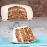 A piece of pecan cake with buttercream icing Stock Photo