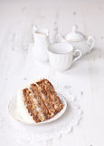 Piece of pecan cake with white buttercream icing Stock Photo