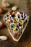 Piece of pecan pie tart with various nuts Stock Photo