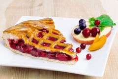 Piece of pie with berry and fruit composition on dish Royalty Free Stock Photography