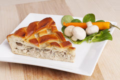 Piece of pie with chicken and vegetable composition on dish Royalty Free Stock Photo